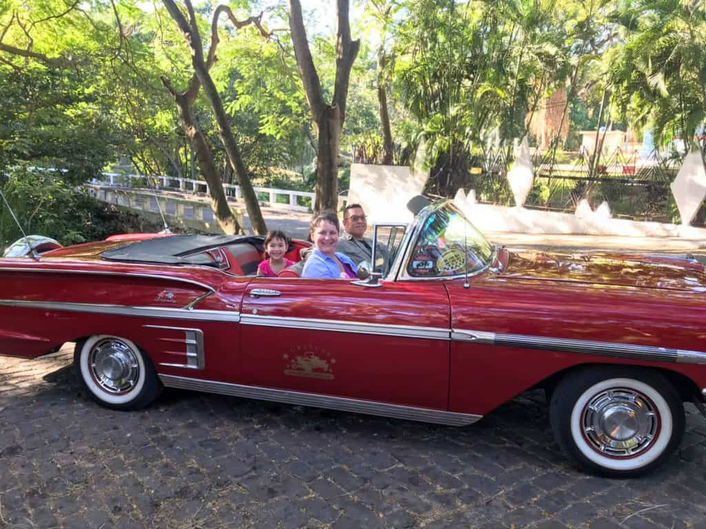 Classic Car Tour, Havana. Family in vintage convertible car.