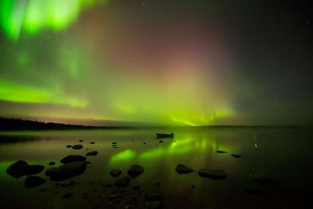 Northern Lights Yellowknife over a lake