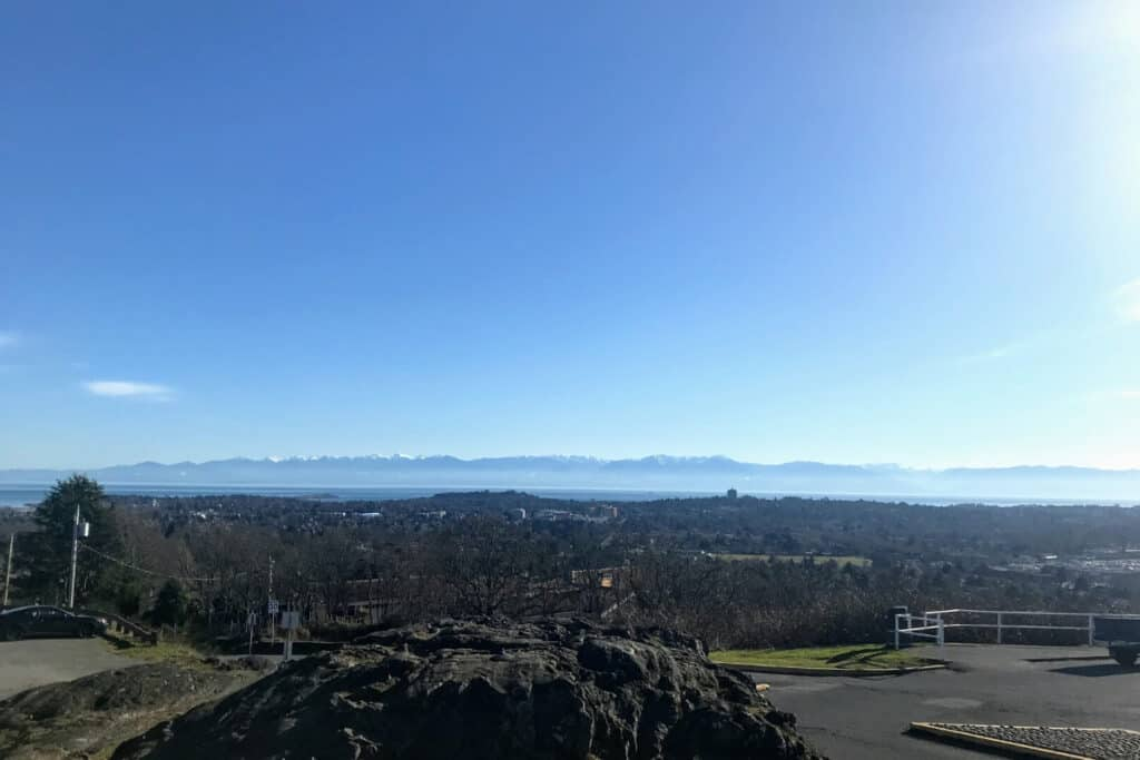 View of Victoria from Mount Tolmie with the ocean and mountains in the distance.