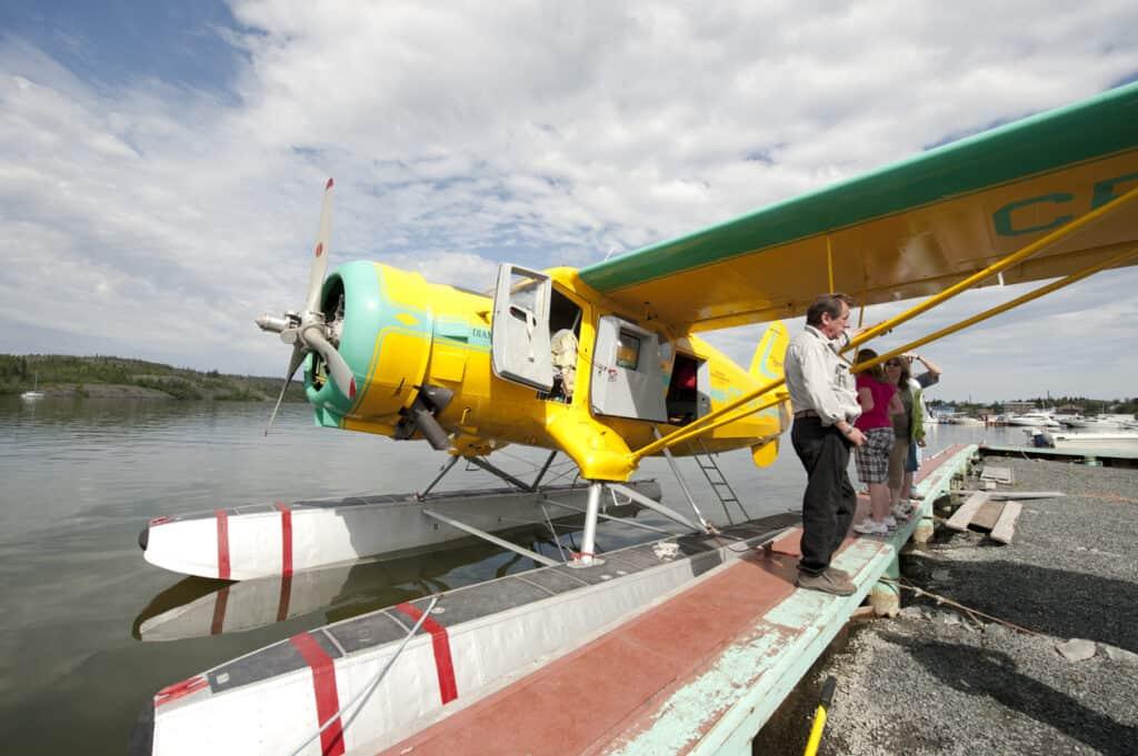 Flightseeing tour, Yellowknife NT. Float plane docked on lake.