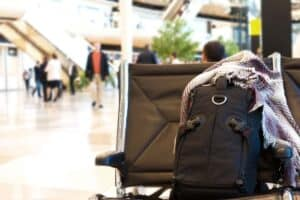 Picture shows a anti theft Backpack on chair at airport
