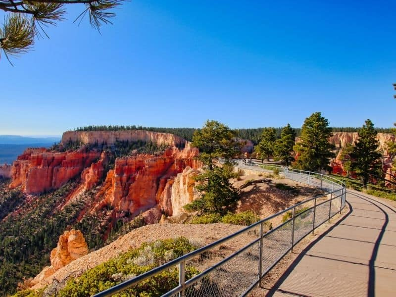 Bryce Canyon, Utah paved trail overlooking canyon and rock formations.