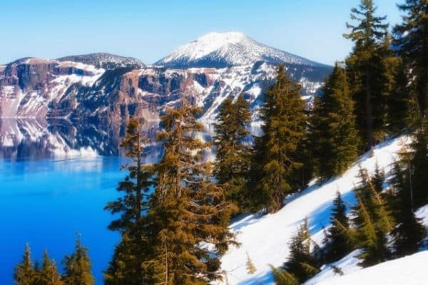 Snowy mountain reflected in Crater Lake, National Park, USA