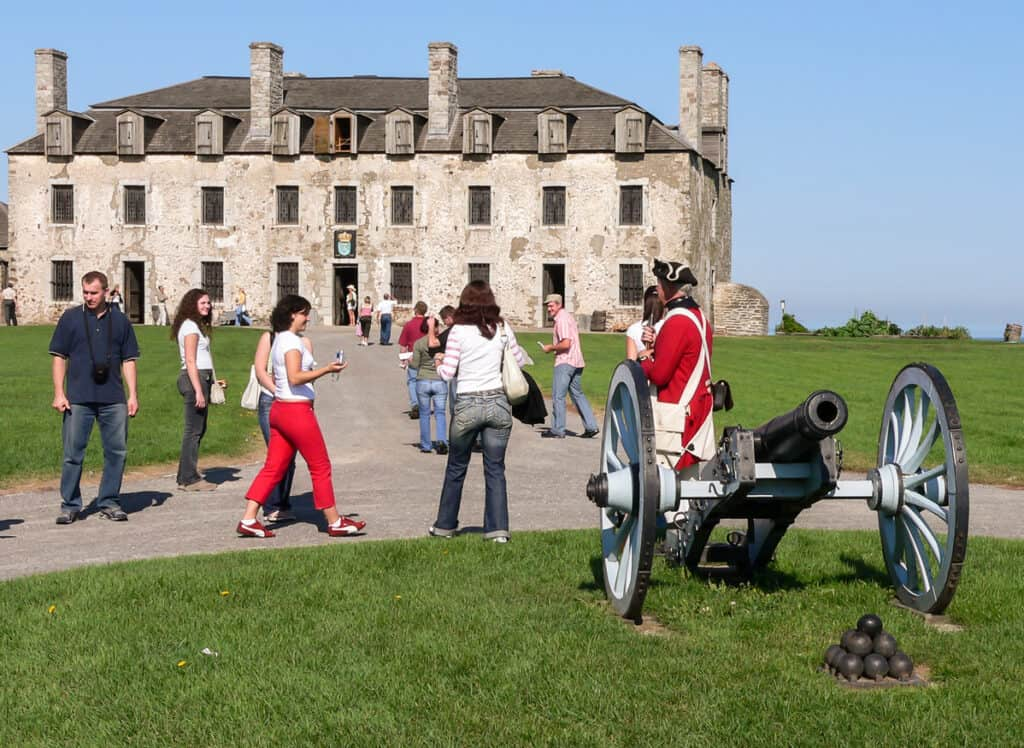 Old Fort Niagara, New York. In front cannon with balls, in background French Castle.