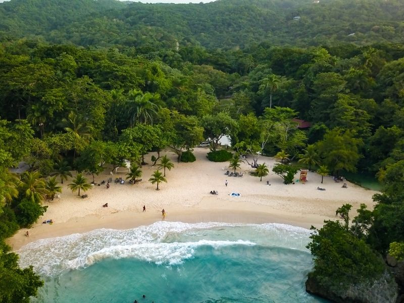 Arial view of Frenchman's Cove, Port Antonio, Jamaica. Tropical forest hills in background.