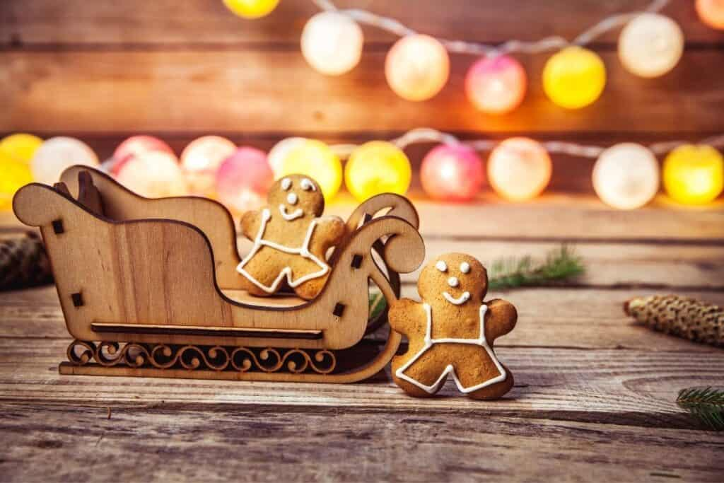 two gingerbread cookies in wooden sleigh, Christmas