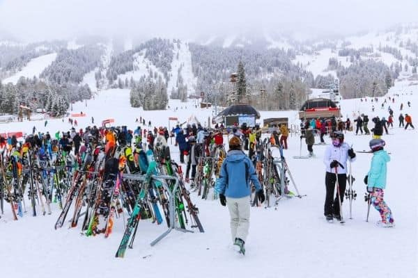 Skis on racks at the base of Jackson Hole Mountain Resort , WY in winter