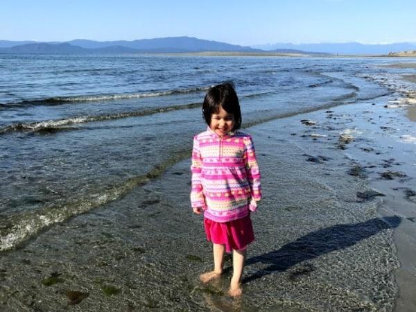 Little girl wading in Parksville Beach ocean