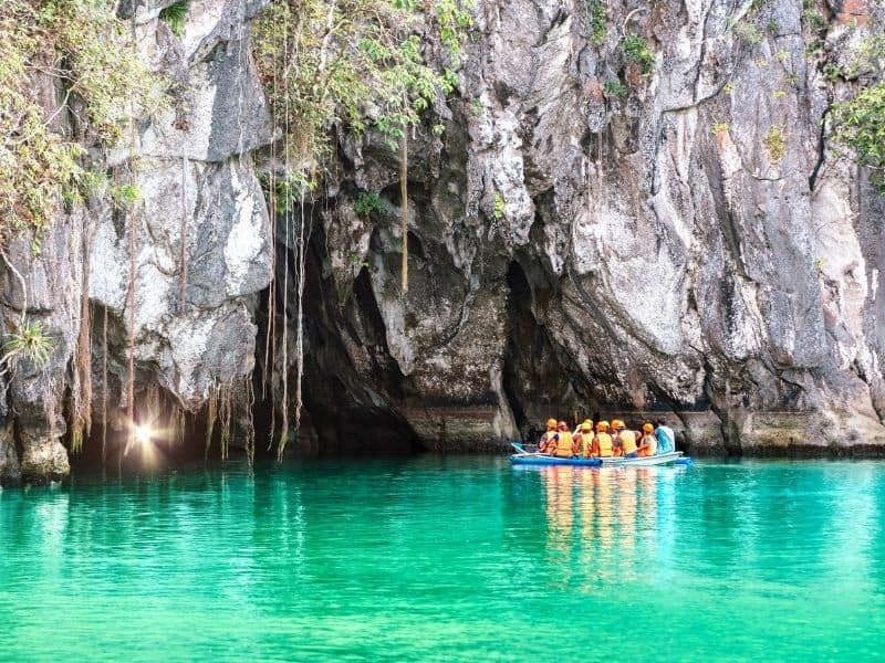 Boat full of people heading into cave in Puerto Princesa Subterranean National Park