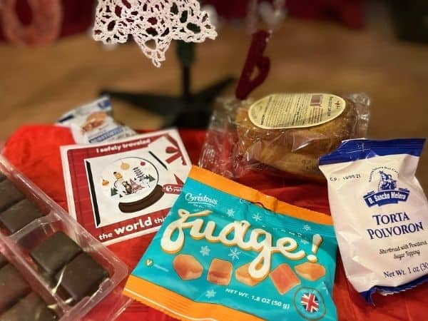 Universal Yums review. Picture of 5 international snacks: fudge, mini cakes, polvoron cookies and Italian sweet bread.