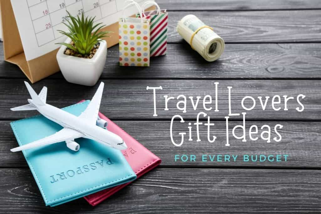 Travel Lovers Gift Ideas with toy airplane, passports, roll of money on wooden background.