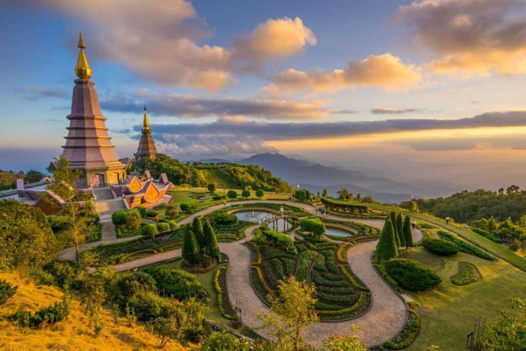 Doi Inthanon Temples - Chang Mai , Thailand with garden and mountain in distance.