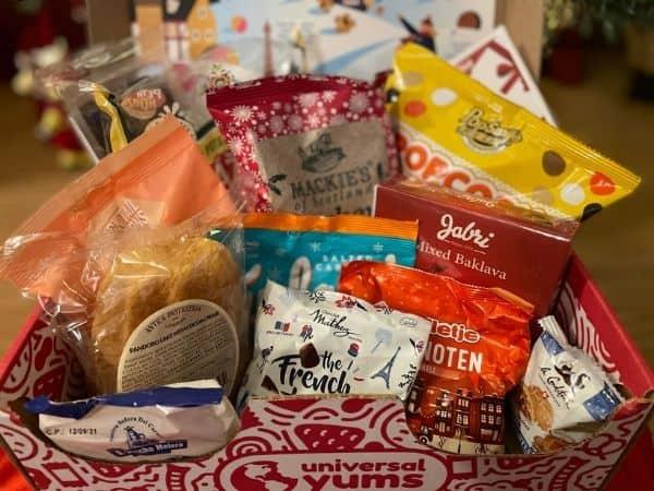 Universal Yums Box, full of sweet and savoury international snacks. Chips, Baklava, Truffles, popcorn and more.