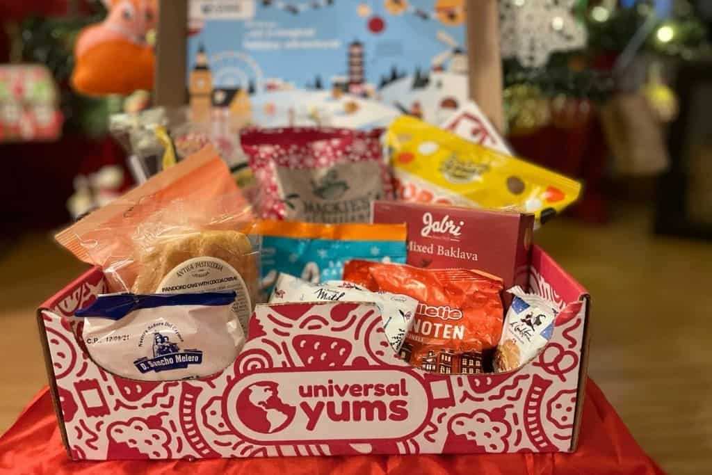 Open Universal Yums subscription box filled with global