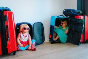 Two young girls in suitcases