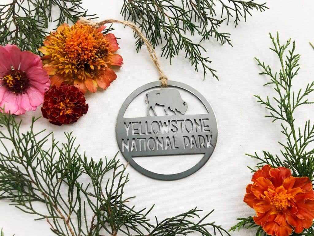 Cicular metal cut out Yellowstone National Park Ornament, with bison.