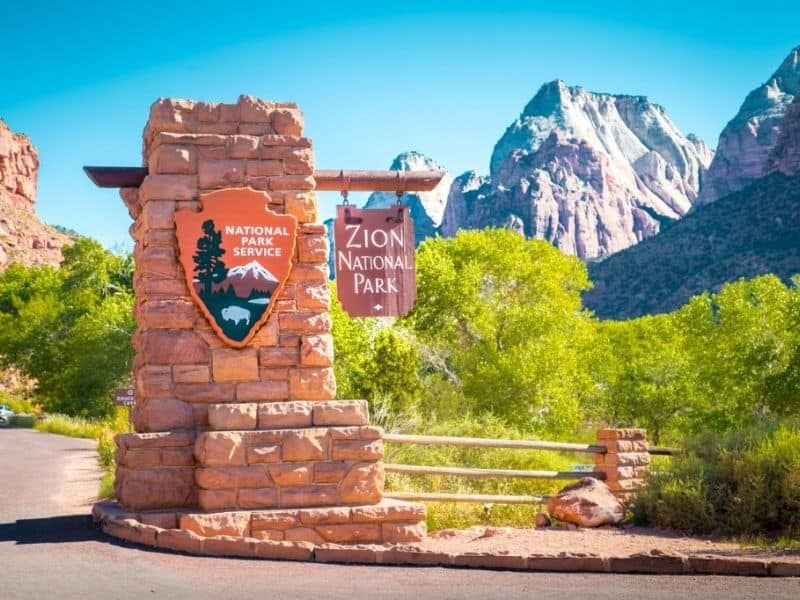 Zion Park Entrance sign, mountains in background